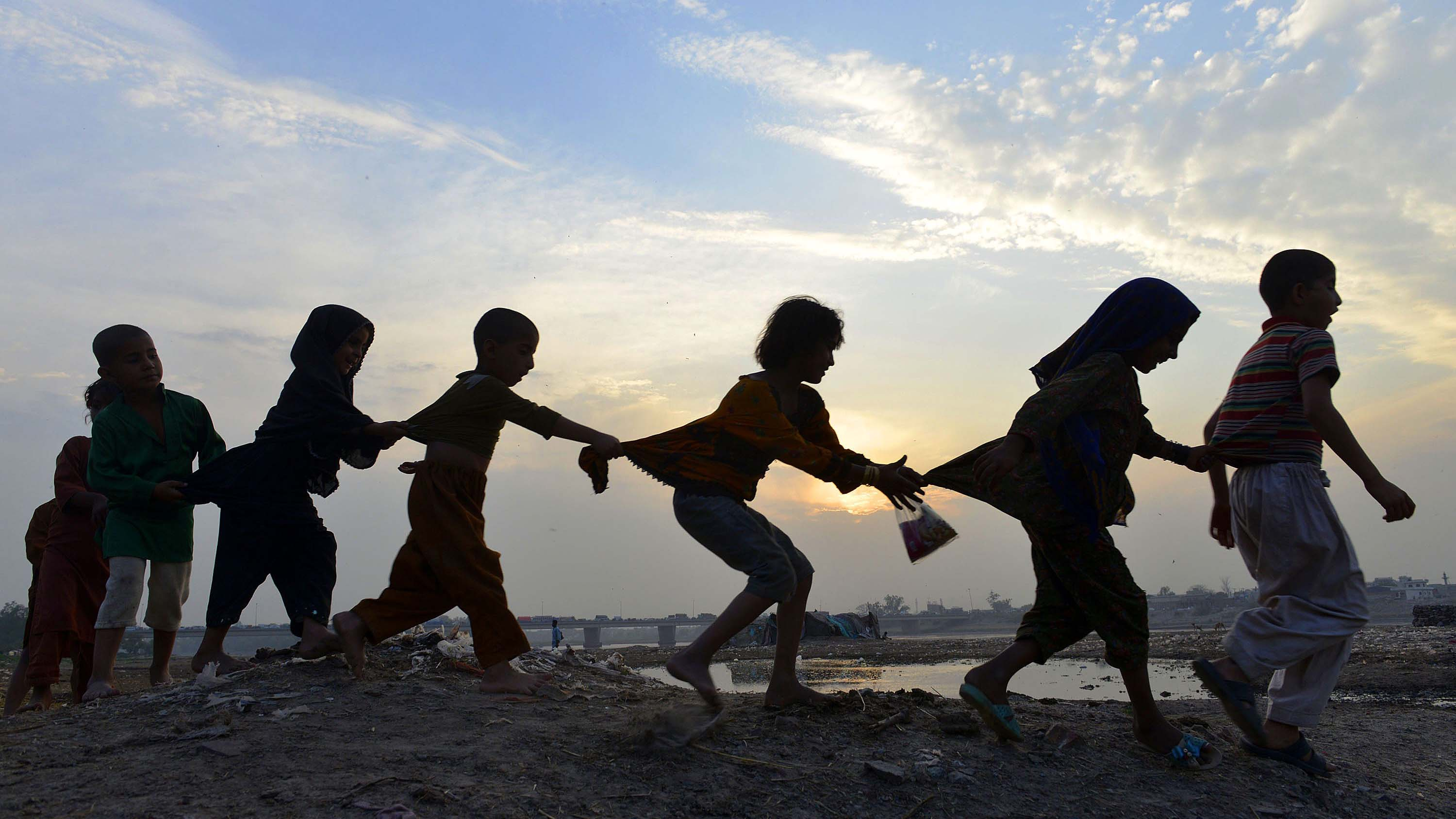 TOPSHOTS Pakistani children play near th